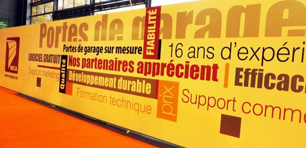 Porte de garage mca actualit s le stand mca au salon for Global market porte de garage